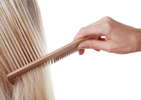 combing blonde hair