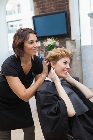 woman getting hair cut at salon