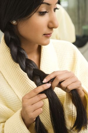 braid hair before bed to prevent damage to extensions