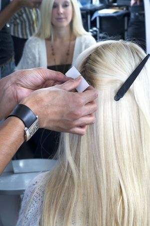 applying hair extensions at salon