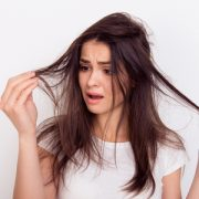 Frustrated woman with split ends